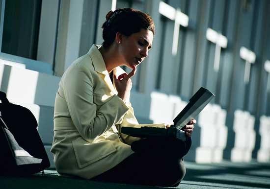 Woman writing and thinking