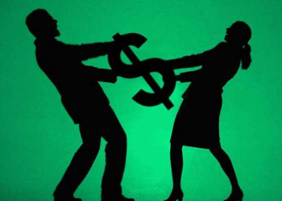 Couple fighting over dollar sign
